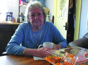 Nancy Fountain sits in the Safe Place kitchen, talking about how she helped herself by helping others.