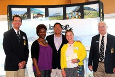 Awardees from the Monterey Peninsula Supply Corps Association are flanked by Big Sur Marathon Executive Director Doug Thurston (left) and Board Chair John Mutty (right).