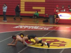 Jonah Thomason (in black) riding his opponent to the ground, early 2nd round of his 120lbs. match.