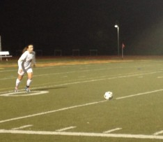 Ashley Aguilera readies herself for a kick in the first half of the Breakers match against Sacred Heart Cathedral