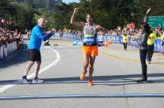 Adam Roach crosses the finish line