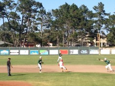 Chis Fife (White) caught in a pickle in the bottom of the 4th inning against RLS