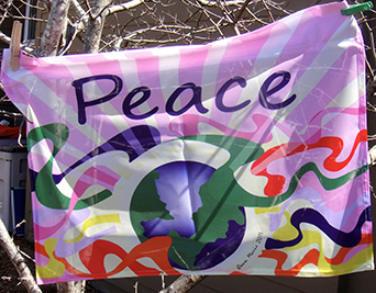 Peace flag designed by local artist Gwen Marie.  Flags will be available to purchase for $10 at International Day of Yoga